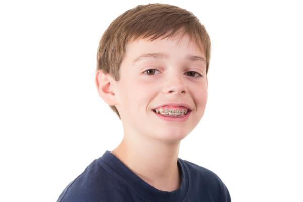 kid with braces or crooked teeth