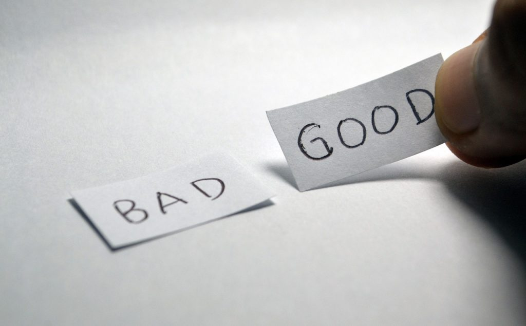 Words bad and good on two slips of paper