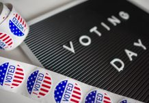 voting day sign with stickers