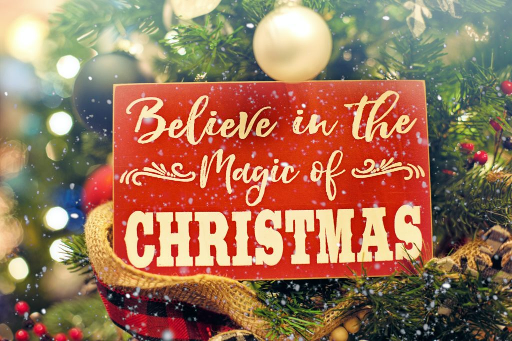 sign that says believe in the magic of Christmas